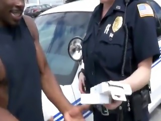 Two cops take long black dong of thief in truck