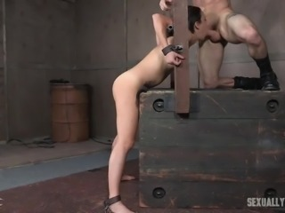 There's a new bondage device in the sex dungeon and it's there so the master can lock up his favorite slave in it. She is put in stocks and then face fucked with his massive cock. She lets him use her pussy, too.