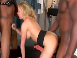 Busty blonde MILF Cheri Deville gets banged by two black studs in a lo