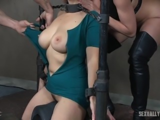 The mistress and master have their sex slave tied up and they rip her clothes off. The slave is embarrassed and humiliated, but after a while she starts to enjoy it. The master shoves his cock deep down her throat