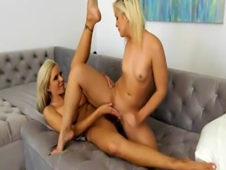 Nina Elle and Cleo Vixen pleasuring each twats on the couch