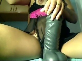 Girl plays with hude green dildo