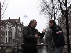 Booted dutch hooker sucks tourist cock
