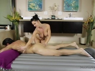 Before a massage, the brunette cleaned his mighty cock under the shower. In the bathtub, she licked his penis passionately and offered sensual blowjob. While doing massage, she rubbed his athletic body with her soft boobs and the male client was in seventh heaven, enjoying all the special services.