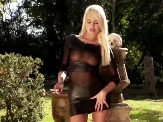 Stunning Lena Love smoking sexily and performing a solo outdoors