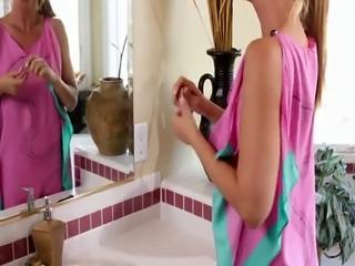 Lesbian beauty sensually scissoring in bath