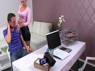 Female agent gives footjob in office