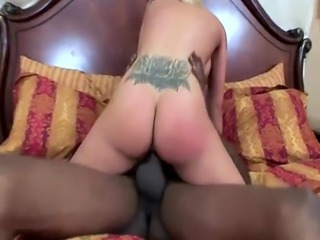 Hot interracial action with a big-boobed starlet