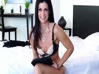 Dark haired milf enjoys dirty talking in bedroom