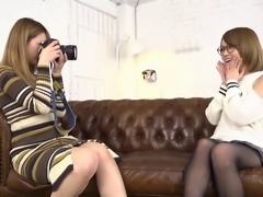 Lesbian Tia in miniskirt spreading legs having her pussy licked