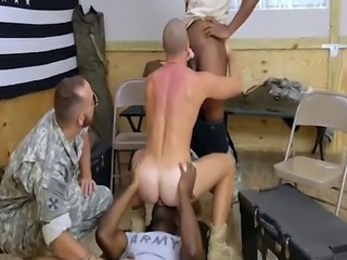 Stunning soldier sucking two long black cocks