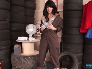 This sexy female mechanic knows how to put on a good striptease show