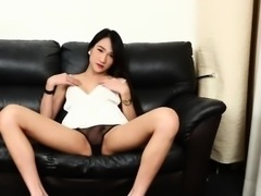 Gorgeous ladyboy tugs herself until climax