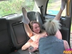 This horny lesbo fake taxi driver cruises around the city, looking for a hot...