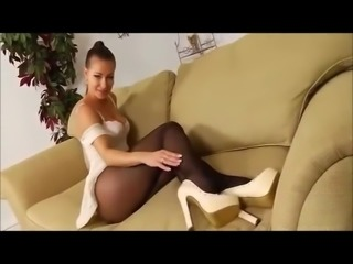 Pretty girl in black pantyhose