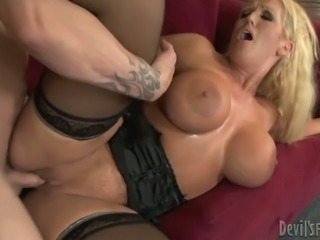 Lustful bitches are riding hard cock fucking in a threesome