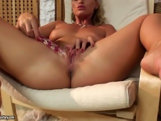 Divine blonde babe with sweet smile opens her self-pleasing secrets