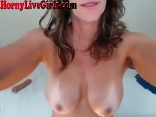 This oil drenched MILF is sexy AF and she is riding her dildo like a pro