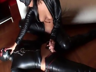 Hot honey in latex rides a dick