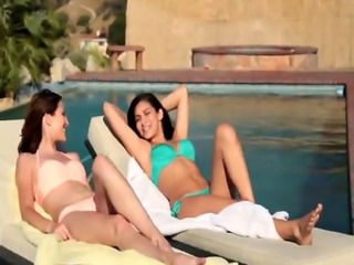 Two very hot brunette lesbian chicks has a lot of fun in a pool
