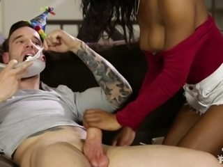 It's his birthday and that can only mean one thing: it's time to give him a blowjob! She opens her mouth wide to fit in as much of his huge cock, as she can. Despite her sucking hard on his dick, he still manages to carry on eating his birthday cake. She's a keeper but I'm not so sure that he is!