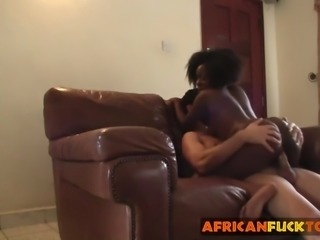 African slut riding long white schlong on couch