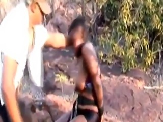 African slut with big natural tits getting her throat fucked and nippl