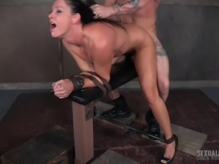 It's another grueling day for submissive MILF India in the sex dungeon, with her exacting and merciless doms. Bent over a table, with her arms tied down, she tries not to gag as her mouth and cunt are fucked relentlessly at the same time. It's a rough life, but she's loving every second of it!