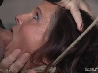 Her body is locked and she is brought down to her knees. Syren de Mer has to learn how to be a good submissive and please her master, so she needs to open up her mouth and begin serving him. Letting him fuck her throat and push his cock balls deep in her face, hoping that he will give her his cum