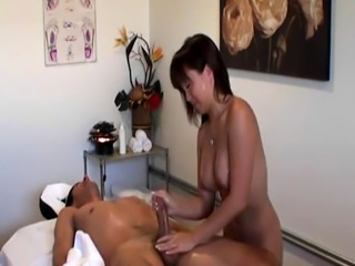 Busty asian masseuse fucked by her client