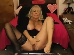Blonde granny with glasses teasing on webcam