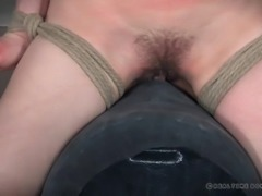 bound and gagged brunette cums hard on the sybian