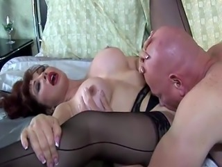 Redhead MILF rides on a fat dick