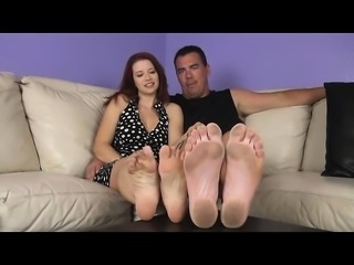Petite redhead enjoys foot fetish session