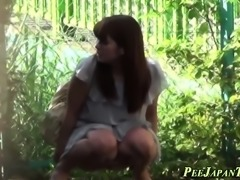 Asian teen peeing outside