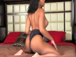 Latex ebony tgirl masturbating in solo action