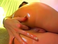 Oiled Beauty Rubs Her Pussy