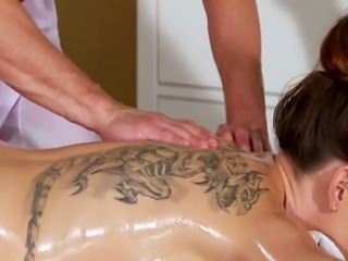 Tattooed brunette gets massage and sex