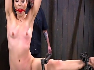 Gagged brunette slave hard flogged