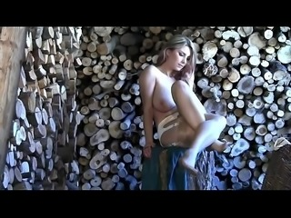 Katerina plays in the wood shed