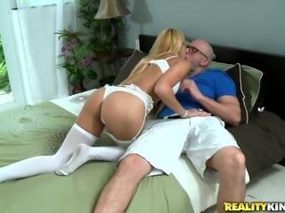 Hypnotically beautiful blonde Marina Angel gives her man a nice blowjob