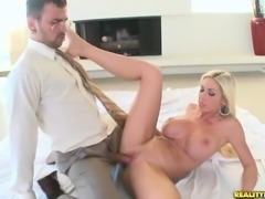 Italian blonde MILF Evita Pozzi with big fake tits gives head to fully...