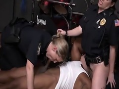 Horny cops enjoy abusing black stud in threesome