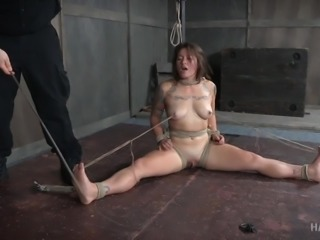 Tess has been tied with her legs spread wide and clamps attached to her nipples. At the end of that rope, they're tied to her toes. If she stretches them forward, those clamps will pull. A vibrator on her clit doesn't help matters any, so she feels the pain as well as the pleasure.
