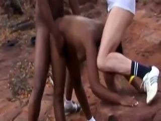 Horny African Teen Gets Double Teamed Outdoors
