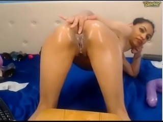 Tan Beauty Dildos her asshole
