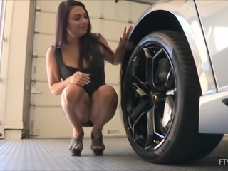 She flashes an upskirt while crawling around in a car