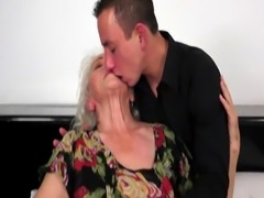 Tittyfucked grandma loves younger cock