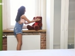 Hot blooded teen Inga is playing with her pussy and teddy bear