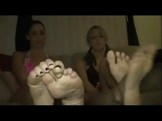 Two Bitchy Teens Tease You with Their Feet